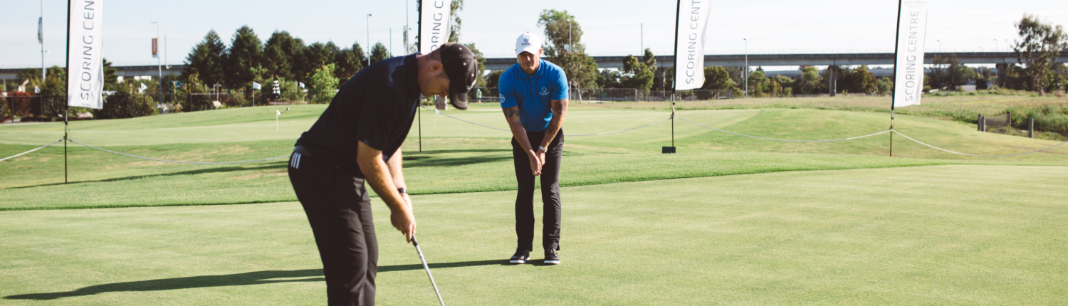 Golfing coach and student in a golf lesson