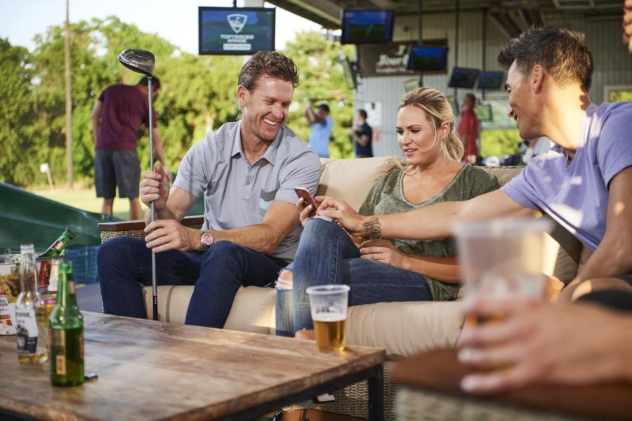 group of people socialising using toptracer by top golf