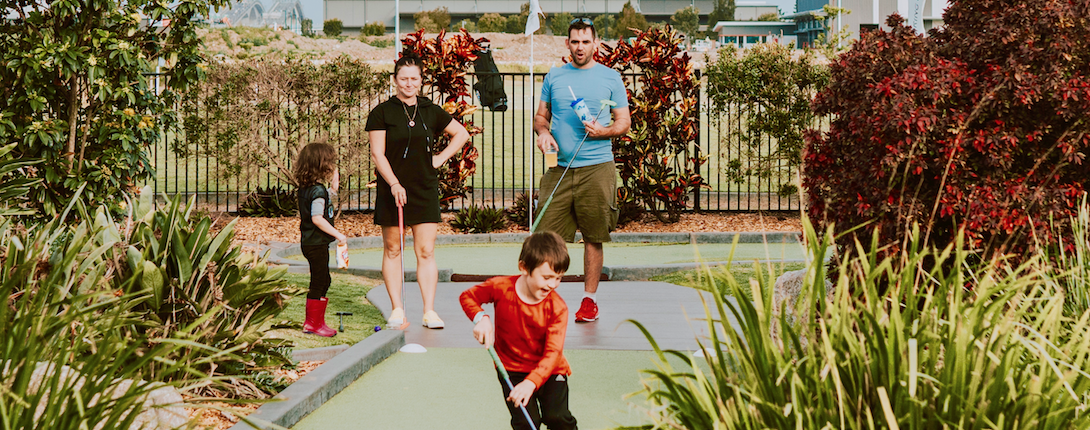 Kids playing mini golf on father's day